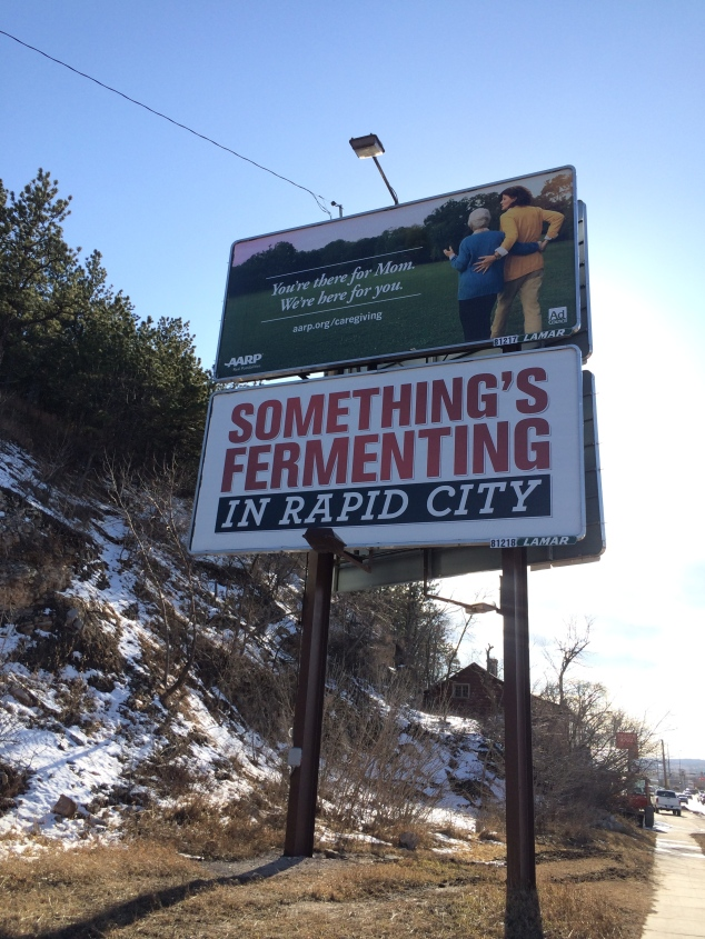 Why would anyone put up this billboard? It's so oddball but very true. I can tell you I have a few things fermenting in my house, wine and Kombucha. True but strange sign.